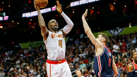 Apr 24, 2017; Atlanta, GA, USA; Atlanta Hawks forward Paul Millsap (4) shoots the ball against the Washington Wizards in the third quarter in game four of the first round of the 2017 NBA Playoffs at Philips Arena. Mandatory Credit: Brett Davis-USA TODAY Sports