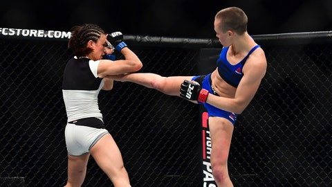 Apr 15, 2017; Kansas City, MO, USA; Rose Namajunas (Red Gloves) fights Michelle Waterson (Blue Gloves) during UFC Fight Night at the Sprint Center. Mandatory Credit: Ron Chenoy-USA TODAY Sports