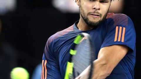 Jo-Wilfried Tsonga of France returns the ball to Lucas Pouille of France, during their final match at the Open 13 Provence tennis tournament in Marseille, southern France, Sunday Feb.26, 2017.(AP Photo/Claude Paris)