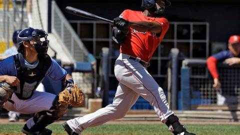 Boston Red Sox's Jackie Bradley Jr. lines a double off Tampa Bay Rays starting pitcher Matt Andriese during the third inning of a spring training baseball game Wednesday, March 15, 2017, in Port Charlotte, Fla. Catching for the Rays is Luke Maile. (AP Photo/Chris O'Meara)