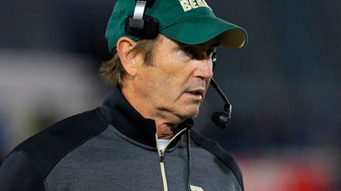 """FILE - In this Sept. 12, 2014, file photo, Baylor coach Art Briles walks the sideline during his team's NCAA college football game against Buffalo in Amherst, N.Y. Baylor University will conduct an investigation into the school's handling of sexual assault allegations against a football player who was allowed to transfer into Briles' program despite a history of disciplinary problems at Boise State. Following the conviction of defensive end Sam Ukwuachu on sexual assault charges, Baylor President Ken Starr on Friday, Aug. 21, 2015, called for a """"comprehensive internal inquiry into the circumstances associated with the case and the conduct of the offices involved."""" (AP Photo/Bill Wippert, File)"""