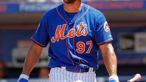 New York Mets' Tim Tebow reacts after striking out in the fifth inning of a spring training baseball game against the Washington Nationals Monday, March 27, 2017, in Port St. Lucie, Fla. (AP Photo/John Bazemore)