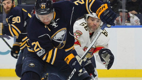 Buffalo Sabres Kyle Okposo (21) is pressured by Florida Panthers Jaromir Jagr (68) during the second period of an NHL hockey game, Monday, March 27, 2017, in Buffalo, N.Y. (AP Photo/Jeffrey T. Barnes)