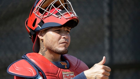 """FILE - In this Feb. 14, 2017, file photo, St. Louis Cardinals catcher Yadier Molina gives a thumbs-up to a pitcher during a spring training baseball workout in Jupiter, Fla. Cardinals general manager John Mozeliak said he's """"hopeful"""" to have a new contract for Molina before opening day but said a deal was """"not done"""" as of Thursday night, March 30. Molina homered in a game against St. Louis' top minor league affiliate while reports surfaced that he's nearing a new contract agreement. Fox Sports reported during the game that Molina and the Cardinals are finalizing a three-year deal worth between $55 million and $65 million. (AP Photo/David J. Phillip, File)"""