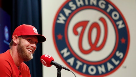 Washington Nationals starting pitcher Stephen Strasburg smiles during a media availability before an exhibition baseball game against the Boston Red Sox was canceled at Nationals Park, Friday, March 31, 2017, in Washington. Strasburg will be the opening day starter. (AP Photo/Alex Brandon)