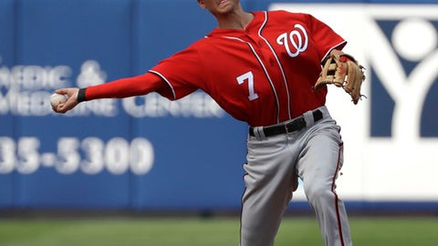 In this photo taken Feb. 25, 2017, Washington Nationals shortstop Trea Turner (7) throws to first during a spring training baseball game against the New York Mets in Port St. Lucie, Fla. If Turner is able to reproduce anything resembling what he did in his first taste of the majors, he will be well-known soon enough. Turner is shifting back to his natural position, shortstop, and will be counted on to spark Washington's offense with power and speed at the top of the batting order. (AP Photo/David J. Phillip)
