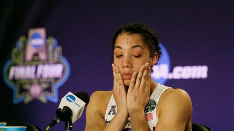 Connecticut guard Gabby Williams wipes away tears as she talks with the media following the team's loss to Mississippi State in an NCAA college basketball game in the semifinals of the women's Final Four, Friday, March 31, 2017, in Dallas. Mississippi State won 66-64. (AP Photo/LM Otero)