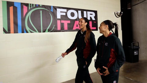 South Carolina forward A'ja Wilson, left, and South Carolina guard Allisha Gray, right, walk to their locker room following  a news conference at the women's Final Four college basketball tournament, Saturday, April 1, 2017, in Dallas. South Carolina will play Mississippi State on Sunday in the NCAA Championship game. (AP Photo/Eric Gay)