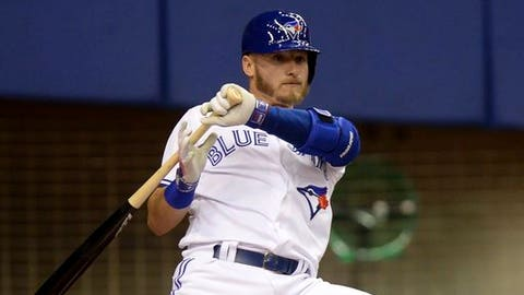 Toronto Blue Jays' Josh Donaldson leans back on an inside pitch during the first inning of an exhibition baseball game against the Pittsburgh Pirates in Montreal on Saturday, April 1, 2017. (Paul Chiasson/The Canadian Press via AP)