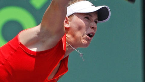 Caroline Wozniacki, of Denmark, serves to Johanna Konta, of Britain, during the women's singles final tennis match at the Miami Open, Saturday, April 1, 2017 in Key Biscayne, Fla. (AP Photo/Wilfredo Lee)
