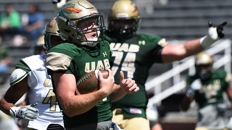 Green quarterback Tyler Johnston scores a touchdown against the Gold defense during UAB's spring NCAA college football game at Legion Field in Birmingham, Ala., Saturday, April 1, 2017. UAB football returns to the field for the first time after the program was eliminated after the 2014 season. (Mark Almond/AL.com via AP)
