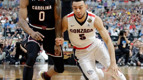 Gonzaga's Nigel Williams-Goss (5) drives against South Carolina's Sindarius Thornwell (0) during the first half in the semifinals of the Final Four NCAA college basketball tournament, Saturday, April 1, 2017, in Glendale, Ariz. (AP Photo/David J. Phillip)