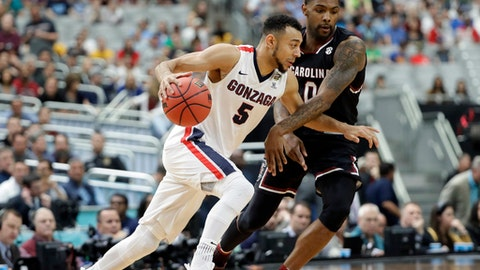 Gonzaga's Nigel Williams-Goss (5) drives around South Carolina's Sindarius Thornwell (0) during the first half in the semifinals of the Final Four NCAA college basketball tournament, Saturday, April 1, 2017, in Glendale, Ariz. (AP Photo/Mark Humphrey)