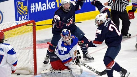 The United States' Kendall Coyne (26) and Hilary Knight (21) celebrate a third period goal against Russia goaltender Maria Sorokina at Ice Hockey Women's World Championship in Plymouth, Mich., on Saturday, April 1, 2017. (Jason Kryk/The Canadian Press via AP)