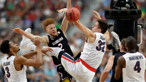 South Carolina's Hassani Gravett (2) battles for a rebound against Gonzaga's Johnathan Williams (3) and Zach Collins (32) during the first half in the semifinals of the Final Four NCAA college basketball tournament, Saturday, April 1, 2017, in Glendale, Ariz. (AP Photo/David J. Phillip)