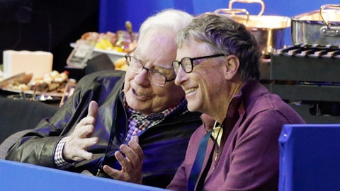 Bill Gates, right, and Warren Buffett talk during a break in the FEI World Cup equestrian jumping grand prix in Omaha, Neb., Saturday, April 1, 2017. Jennifer Gates, daughter of Bill Gates, is one of the contestants. (AP Photo/Nati Harnik)