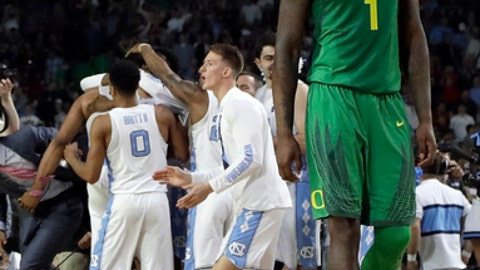 Oregon's Jordan Bell (1) walks off the court as North Carolina players celebrate after the semifinals of the Final Four NCAA college basketball tournament, Saturday, April 1, 2017, in Glendale, Ariz. North Carolina won 77-76. (AP Photo/David J. Phillip)