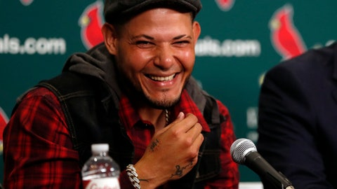 St. Louis Cardinals catcher Yadier Molina smiles during a news conference ahead of a baseball game against the Chicago Cubs, Sunday, April 2, 2017, in St. Louis. The Cardinals have finalized a contract extension with seven-time All-Star Molina that runs through the 2020 season. (AP Photo/Jeff Roberson)