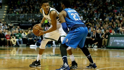 MILWAUKEE, WI - APRIL 02:  Giannis Antetokounmpo #34 of the Milwaukee Bucks handles the ball while being guarded by Wesley Matthews #23 of the Dallas Mavericks in the first quarter at BMO Harris Bradley Center on April 2, 2017 in Milwaukee, Wisconsin. NOTE TO USER: User expressly acknowledges and agrees that , by downloading and or using this photograph, User is consenting to the terms and conditions of the Getty Images License Agreement. (Photo by Dylan Buell/Getty Images)