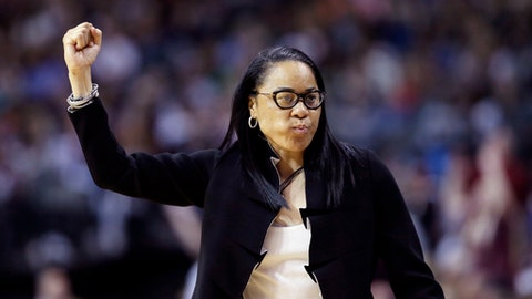 South Carolina head coach Dawn Staley signals toher players during the first half against Mississippi State in the final of NCAA women's Final Four college basketball tournament, Sunday, April 2, 2017, in Dallas. (AP Photo/Tony Gutierrez)