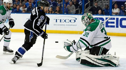 Tampa Bay Lightning's Tyler Johnson looks for a rebound in front of Dallas Stars goalie Kari Lehtonen, of Finland, during the second period of an NHL hockey game Sunday, April 2, 2017, in Tampa, Fla. (AP Photo/Mike Carlson)