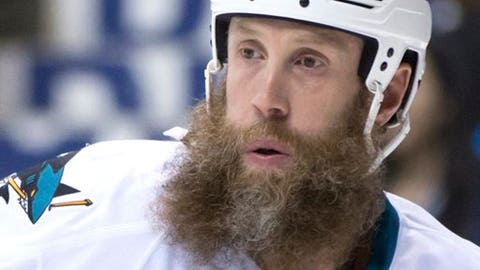 San Jose Sharks' Joe Thornton watches play during the first period of the team's NHL hockey game against the Vancouver Canucks on Sunday, April 2, 2017, in Vancouver, British Columbia. (Darryl Dyck/The Canadian Press via AP)
