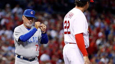 Chicago Cubs manager Joe Maddon, left, gestures to members of the St. Louis Cardinals after shaking hands with Cardinals manager Mike Matheny, right, before a baseball game Sunday, April 2, 2017, in St. Louis. (AP Photo/Jeff Roberson)