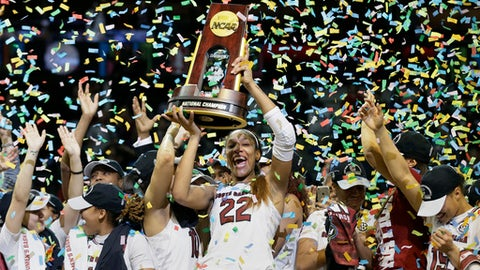 South Carolina forward A'ja Wilson (22) holds the trophy as she and her teammates celebrate a win over Mississippi State in the final of NCAA women's Final Four college basketball tournament, Sunday, April 2, 2017, in Dallas. South Carolina won 67-55. (AP Photo/Tony Gutierrez)