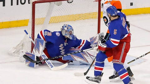 New York Rangers goalie Henrik Lundqvist (30) makes a save against the Philadelphia Flyers during the third period of an NHL hockey game, Sunday, April 2, 2017, in New York. The Rangers won 4-3. (AP Photo/Julie Jacobson)