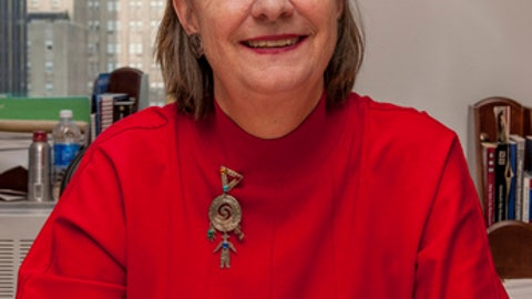 In a Sept. 17, 2012, photo provided by Major League Baseball, Katy Feeney poses for a portrait in her office at MLB headquarters in New York.  Feeney, a baseball executive for four decades and a daughter of former National League President Chub Feeney, has dies. She was 68. Feeney died Saturday, April 1, 2017, while visiting relatives in Maine. She had retired from baseball in December after working her final postseason. (Jessica Foster/MLB Photos via AP)