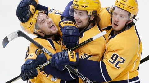 FILE - In this Feb. 25, 2017, file photo, Nashville Predators left wing Viktor Arvidsson, left, of Sweden, celebrates with Filip Forsberg (9), also of Sweden, and Ryan Johansen (92) after scoring an empty-net goal against the Washington Capitals during the third period of an NHL hockey game, in Nashville, Tenn. Filip Forsberg is the first in Predators' history to score 30 or more goals twice. Viktor Arvidsson is just behind enjoying the best season of his young career. Together, the young Swedes anchor Nashville's top line pushing for a third straight playoff berth. (AP Photo/Mark Humphrey, File)