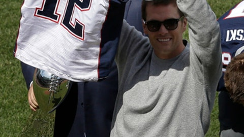 New England Patriots quarterback Tom Brady displays his recovered jersey, which was stolen from the locker room after the Patriots' February Super Bowl victory over the Atlanta Falcons in Houston, during pregame ceremonies before a baseball game between the Boston Red Sox and the Pittsburgh Pirates on opening day at Fenway Park, Monday, April 3, 2017, in Boston. (AP Photo/Steven Senne)