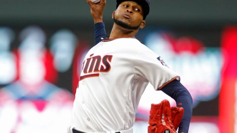 Minnesota Twins pitcher Ervin Santana throws against the Kansas City Royals in the first inning of a baseball game, Monday, April 3, 2017 in Minneapolis. (AP Photo/Jim Mone)
