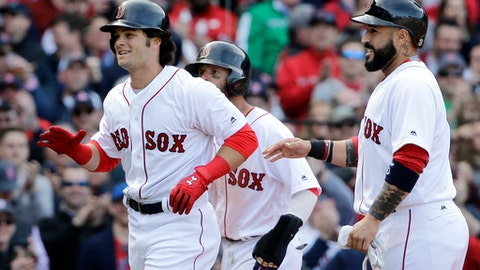 Boston Red Sox's Andrew Benintendi, left, celebrates his three-run homer with teammates Dustin Pedroia, partially hidden, and Sandy Leon, right, in the fifth inning of a baseball game against the Pittsburgh Pirates at Fenway Park, Monday, April 3, 2017, in Boston. (AP Photo/Elise Amendola)