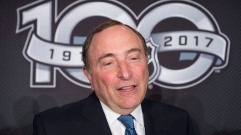 FILE - This March 17, 2017 file photo shows NHL Commissioner Gary Bettman speaking with the media following a news conference in Ottawa. The NHL announced Monday, April 3, 2017 that it will not participate in the 2018 Winter Olympics in South Korea, saying it sees no tangible benefit in halting its season for three weeks next February despite clear signs from the world's best players that they want to go. (Adrian Wyld/The Canadian Press via AP, file)