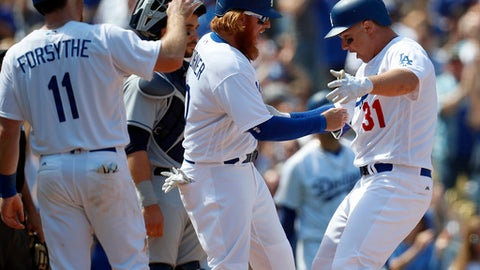 Los Angeles Dodgers' Joc Pederson, right, celebrates with Justin Turner, center, and Logan Forsythe, left, after hitting a grand slam home run during the third inning of a baseball game against the San Diego Padres, Monday, April 3, 2017, in Los Angeles. (AP Photo/Ryan Kang)