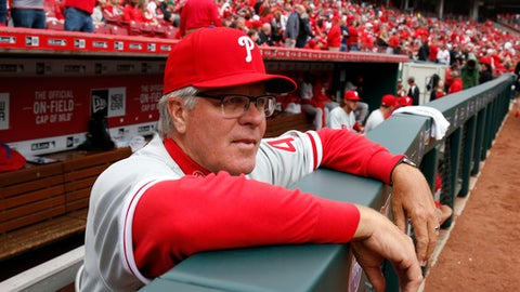 Philadelphia Phillies manager Pete Mackanin waits for play to begin before the first inning of a baseball game against the Cincinnati Reds, Monday, April 3, 2017, in Cincinnati. (AP Photo/Gary Landers)
