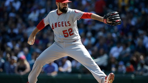 FILE - In this Sept. 4, 2016, file photo, Los Angeles Angels starting pitcher Matt Shoemaker throws against the Seattle Mariners in a baseball game in Seattle. Shoemaker no longer thinks about that screaming line drive that hit him above the right ear last September in Seattle. He will make his first start since when he takes the ball for the Los Angeles Angels on Tuesday, April 4, 2017, night at Oakland, exactly six months to the day after his frightening injury, and now wearing protective headgear. (AP Photo/Elaine Thompson, File)