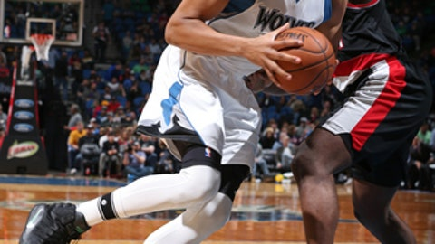 MINNEAPOLIS, MN - APRIL 03:  Karl-Anthony Towns #32 of the Minnesota Timberwolves drives to the basket against the Portland Trail Blazers at the Target Center in Minneapolis, Minnesota on April 3, 2017. NOTE TO USER: User expressly acknowledges and agrees that, by downloading and/or using this photograph, user is consenting to the terms and conditions of the Getty Images License Agreement. Mandatory Copyright Notice: Copyright 2017 NBAE (Photo by David Sherman/NBAE via Getty Images)