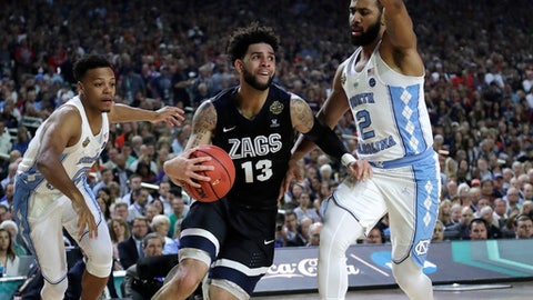 Gonzaga guard Josh Perkins (13) drives past North Carolina guard Joel Berry II, right, during the first half in the finals of the Final Four NCAA college basketball tournament, Monday, April 3, 2017, in Glendale, Ariz. (AP Photo/David J. Phillip)