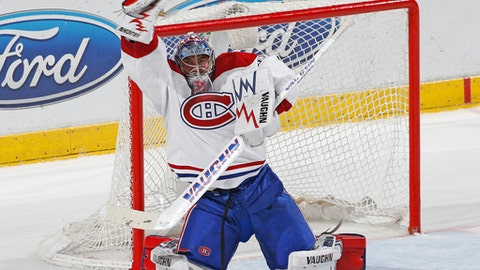 Montreal Canadiens goaltender Charlie Lindgren (40) makes a glove save on a shot by the Florida Panthers during the third period of an NHL hockey game, Monday, April 3, 2017, in Sunrise, Fla. The Canadiens defeated the Panthers 4-1. (AP Photo/Joel Auerbach)