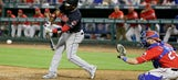 AL champion Indians rally in 9th, win opener 8-5 at Texas
