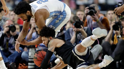 Gonzaga's Josh Perkins and North Carolina's Joel Berry II (2) collide as they reach for a loose ball during the second half in the finals of the Final Four NCAA college basketball tournament, Monday, April 3, 2017, in Glendale, Ariz. (AP Photo/David J. Phillip)