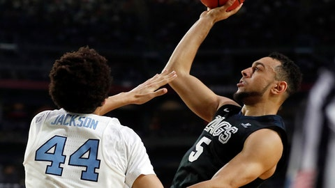Gonzaga's Nigel Williams-Goss (5) shoots over North Carolina's Justin Jackson (44) during the second half in the finals of the Final Four NCAA college basketball tournament, Monday, April 3, 2017, in Glendale, Ariz. (AP Photo/Charlie Neibergall)