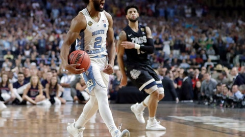 North Carolina's Joel Berry II (2) celebrates after the finals of the Final Four NCAA college basketball tournament against Gonzaga, Monday, April 3, 2017, in Glendale, Ariz. North Carolina won 71-65. (AP Photo/David J. Phillip)