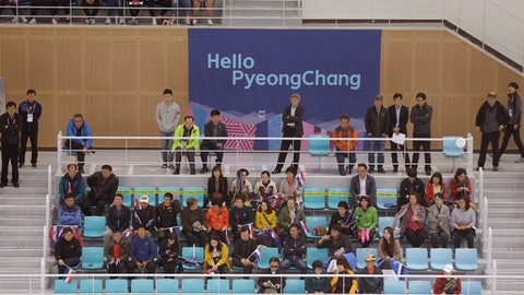 People watch the IHF Ice Hockey U18 World Championship Division II Group A game between Croatia and Estonia at Kwandong Hockey Center in Gangneung, South Korea, Tuesday, April 4, 2017. South Korean Olympic organizers still hope to see NHL players competing at next year's Winter Games despite the National Hockey League's insistence it won't happen. (AP Photo/Ahn Young-joon)