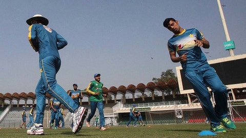 In this March 16, 2017 photo, Pakistan leg-spinner Shadab Khan, right, jogs during a training camp of the national team, at the Gaddafi Stadium in Lahore, Pakistan. Shadab made his international debut in last week's Twenty20 series against the West Indies and could hardly have been more impressive, capturing 10 wickets against the world champions to be named player of the series. (AP Photo/K.M. Chaudary)