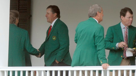 FILE - In this Tuesday, April 3, 2007, file photo, Phil Mickelson, second from left, shakes hands with Bernhard Langer of Germany during the Masters Champions Dinner at the Augusta National Golf Club in Augusta, Ga. Also pictured are past winners Tom Watson, far right, and Fuzzy Zoeller. Mickelson can think of only one way that the Tuesday, April 4, 2017, night dinner for Masters champions can get any better: to be the host. One of the best traditions at the Masters will take place when Danny Willett hosts a room filled with green jackets. (Chris Thelen/The Augusta Chronicle via AP, File)