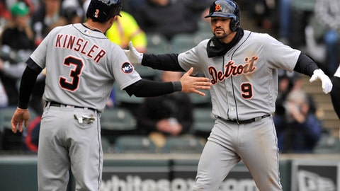 Detroit Tigers' Nick Castellenos (9) celebrates with teammate Ian Kinsler (3) at home plate after hitting a two-run home run during the second inning of a baseball game against the Chicago White Sox on opening day Tuesday, April 4, 2017, in Chicago. (AP Photo/Paul Beaty)