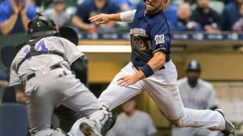 Milwaukee Brewers' Travis Shaw is tagged out at home by Colorado Rockies' Tony Walters during the fourth inning of a baseball game Tuesday, April 4, 2017, in Milwaukee. (AP Photo/Tom Lynn)
